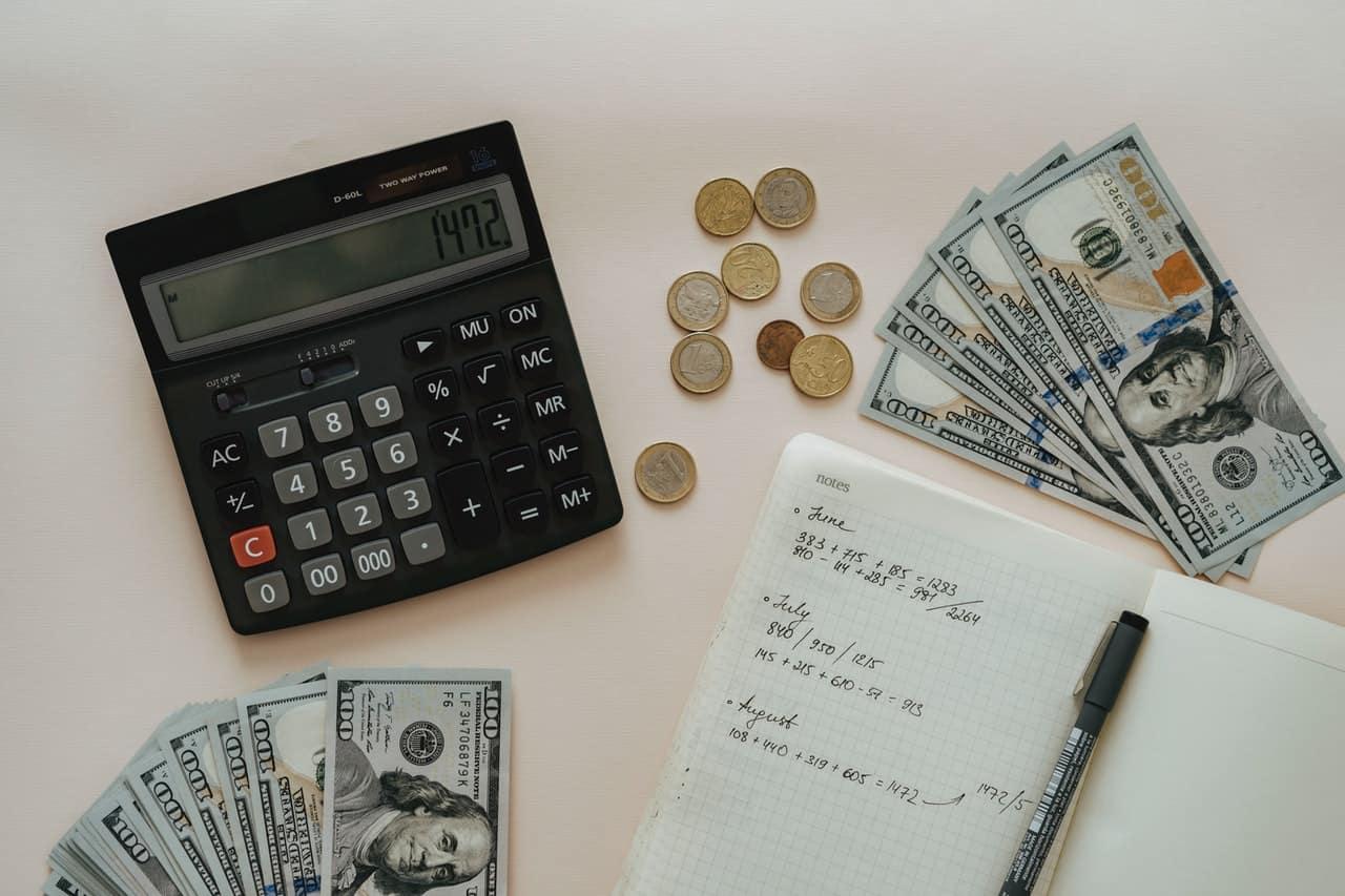 calculator laptop and money